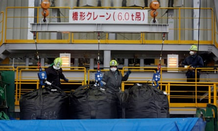 Workers at a soil separation facility for decontamination work in Okuma