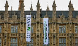 Protesters calling for a halt to the Heathrow airport expansion unfurl banners on the Houses of Parliament in 2008.