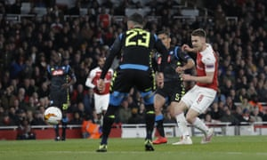 Aaron Ramsey scores with a precise finish.