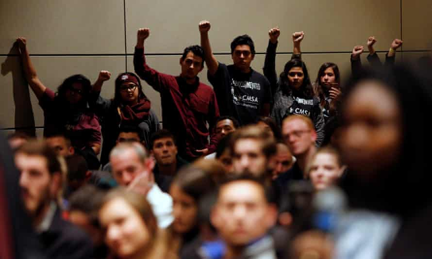 Undocumented Texas A&M students and their supporters protest silently as Spencer speaks.