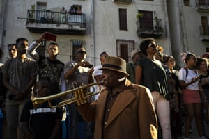 A Cuban trumpeter entertains the crowd