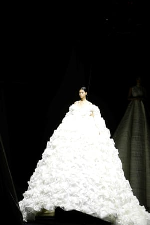 The collection was produced in collaboration with photographer Nick Knight. Gowns were supersized to serve as a canvas for his abstract projections, watch the video here.