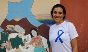 Brisa De Angulo stands by the painting she designed when she founded her centre outside Cochabamba as a teenager