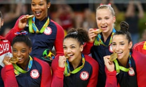 From left: Simone Biles, Gabby Douglas, Laurie Hernandez, Madison Kocian and Aly Raisman after winning gold in the women's team final.