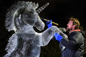Darren Jackson takes care as he puts the finishing touches to an ice sculpture of a unicorn