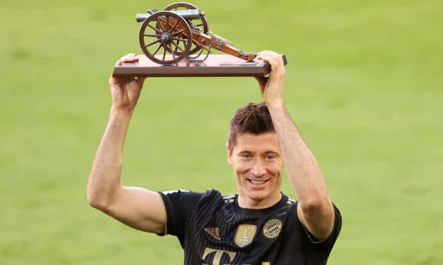 Bayern Munich's Robert Lewandowski with the Bundesliga top scorer award after his side's 5-2 win over Augsburg.
