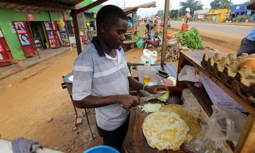 Young man preparing rolex - Uganda's favourite street food.