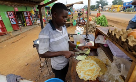 Young man preparing rolex - Uganda's favourite street food.