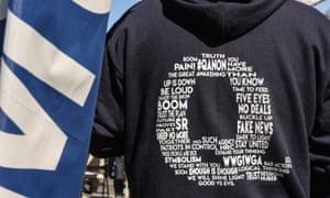 A QAnon sweatshirt at a Trump rally in October.