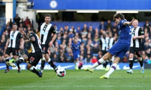 Marcos Alonso slots in the opening goal for Chelsea.