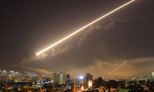 Damascus skies erupt with surface to air missile fire as the US launches an attack on Syria