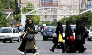 Iranian women cross a road in the capital Tehran on June 15.