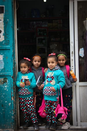 Two sets of twin girls who live in Aida