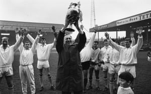Manchester City's manager, Joe Mercer, holds the first division trophy at Maine Road in 1968.