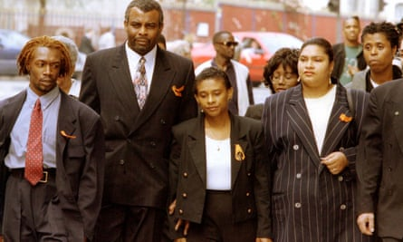 Neville Lawrence and his wife Doreen (centre right) arrive at the Old Bailey in April 1996 surrounded by supporters for the start of their private prosecution of three youths accused of killing their son Stephen