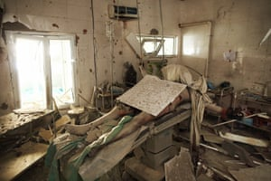 Baynazar Mohammad Nazar, a patient, lies dead on the operating table of Operating Theatre 3, inside the MSF Kunduz Trauma Center in Afghanistan following an errant attack by an American gunship.