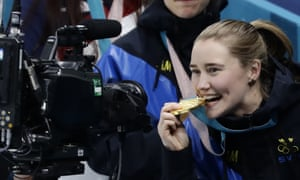 Sara McManus bites her medal after winning the women's curling gold in Pyeongchang.