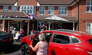 Relatives arriving to visit residents during a drive-through visit to Gracewell care home in Adderbury, Oxfordshire.