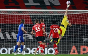 Southampton keeper Alex McCarthy tips the ball over the bar.