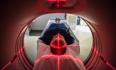 A person undergoing a CT scan