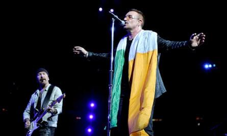 Bono draped in the Irish flag at a 2009 concert.