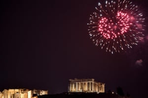 Fireworks explode over the Parthenon temple atop the Acropolis hill in Athens.