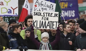 The Swedish climate activist Greta Thunberg, centre, joins a 'Fridays for Future' march in Hamburg on Friday.