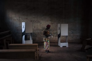 A voter prepares to vote at the Barthélemy Boganda high school polling station during the country's presidential and legislative elections.