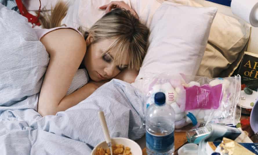 Teenage girl asleep in messy bedroom