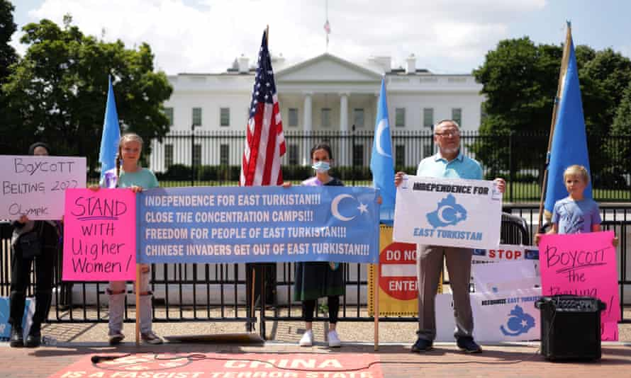 Activists participate in a demonstration against the 2022 Olympics in China, in Washington, DC.