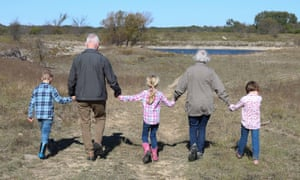 Grandparents going for a walk with their grandchildren