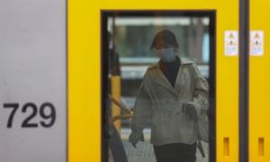 A Sydney train passenger wears a mask