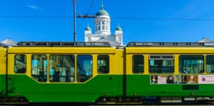 A tram goes past Helsinki Cathedral.