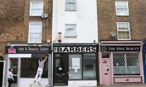 Work commences on the frontage of a Hair & Beauty Salon as businesses start getting ready to reopen