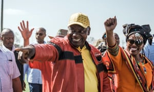 South African president Cyril Ramaphosa waves to supporters at a rally to mark May Day.