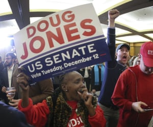 Supporters of Roy Moore's opponent Doug Jones react to the election results.