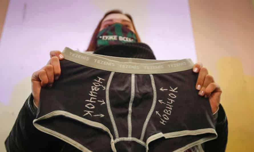 An activist holds underwear with writing saying 'novichok' at a rally in St Petersburg supporting Alexei Navalny.