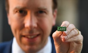 Matt Hancock showing the 'Care' badge, described as a 'badge of honour' for care workers so they can get the same public recognition as NHS staff.