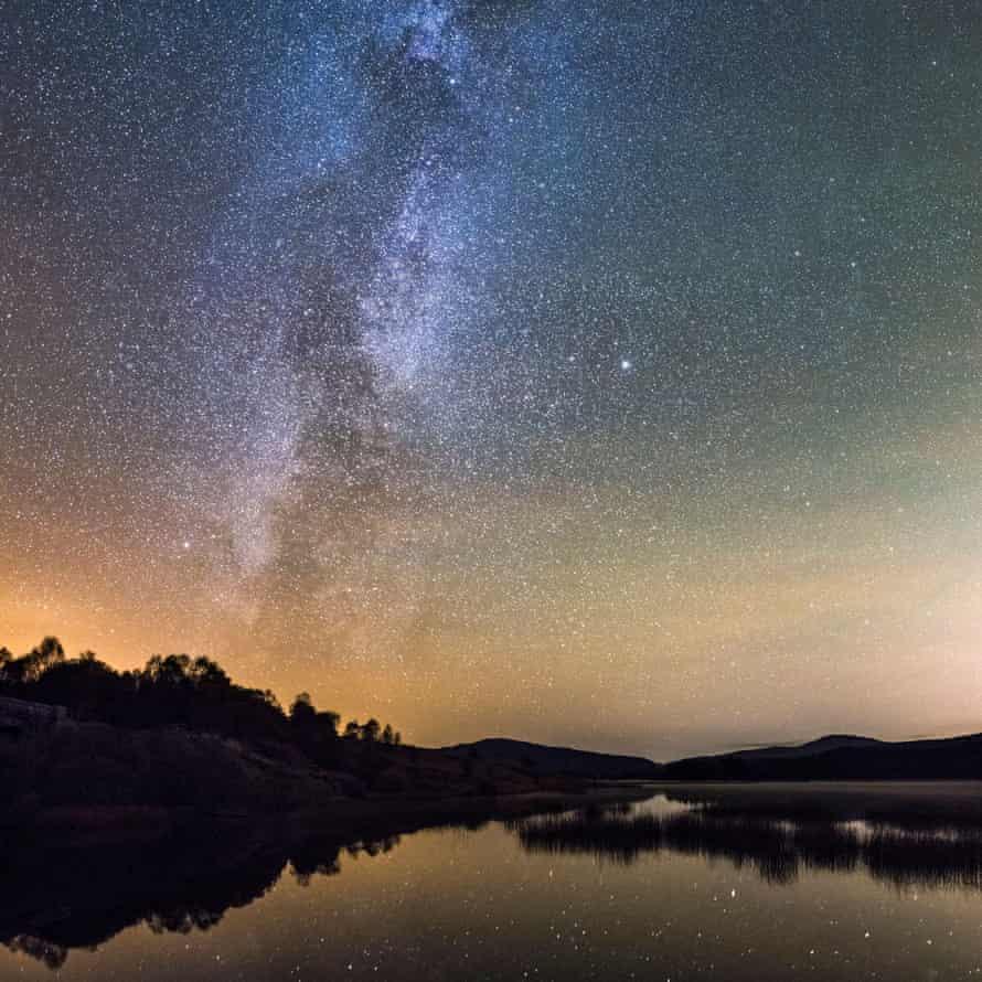 Milky Way and stars over Stroan Loch, Scotland.