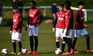 Manchester United Under-18s members, pre-lockdown: younger players are staying involved with worksheets and online Q&As with first-team players and coaching staff.