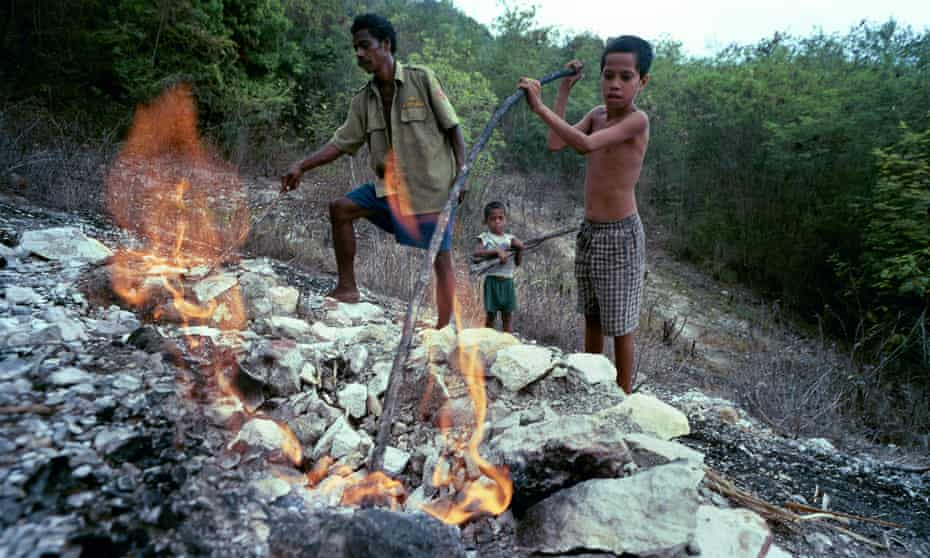 Oil and gas bubble up from a small bore hole sunk by Australians near Vikeke, Timor-Leste.