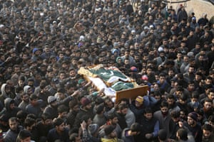 Marhama, Kashmir Muslim villagers carry the body of a suspected rebel