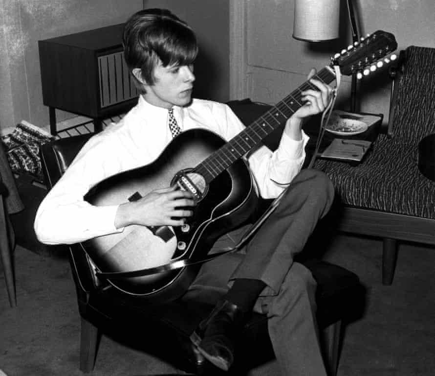 Davie Jones in 1965, playing a Framus 12-string acoustic guitar.