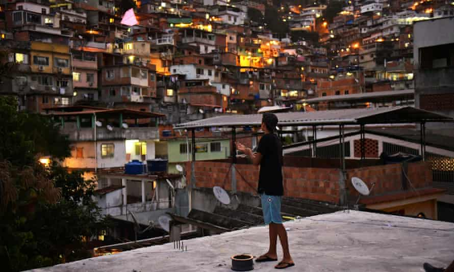 A boy flies a kite in the Vidigal favela, where author Geovani Martins lives, on 18 May.