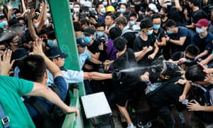Anti-extradition bill protesters are sprayed with pepper spray by police in Hong Kong on 13 July.