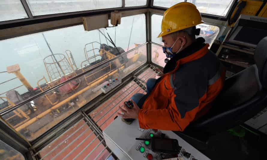 A crane operator at work at the international container terminal of Hefei port in east China's Anhui province.