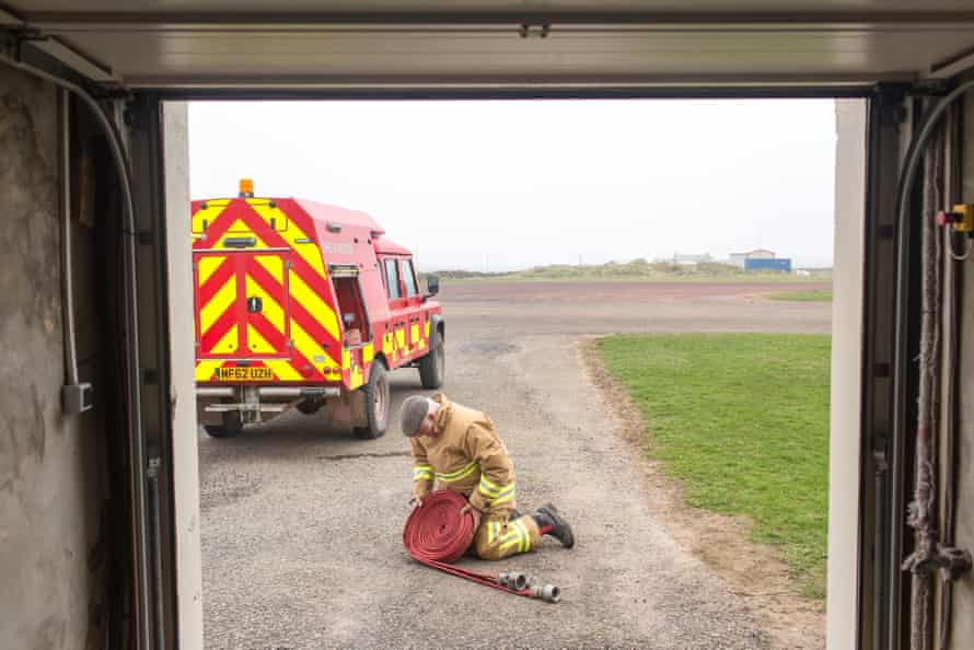Billy Muir checks the hose in his role as a retained firefighter