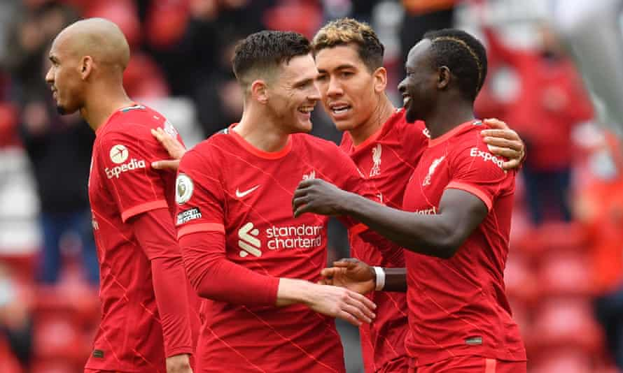 Sadio Mané (right) celebrates with Andrew Robertson and Roberto Firmino after scoring Liverpool's second goal in the 2-0 home win over Crystal Palace.