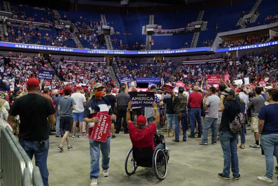 Supporters listen to Trump speak.