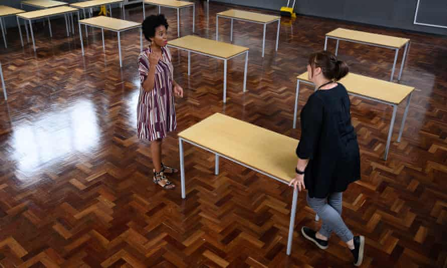 Teacher Muriel Thompson and assistant headteacher Liz McMullen sets up a temporary classroom at Muswell Hill primary school in London on 3 June.